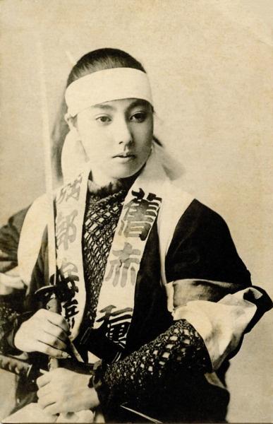 Geisha in an Odori (Dance) costume, dressed either for the Katana Odori or for a Kabuki-style dance, 1900. S)