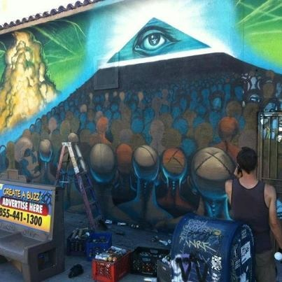 Mural    Imagery: Pyramid with Eye as capstone, sheeple, chemtrails in sky