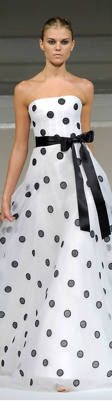 Oscar De La Renta All the polkadots are connected to my wedding dress, an original one of his polkadot collection