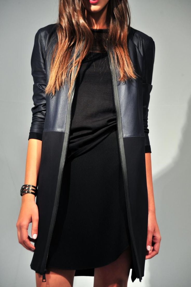 I am a sucker for anything with leather or faux leather trim, pockets and the like.  I would wear this jacket all the time.