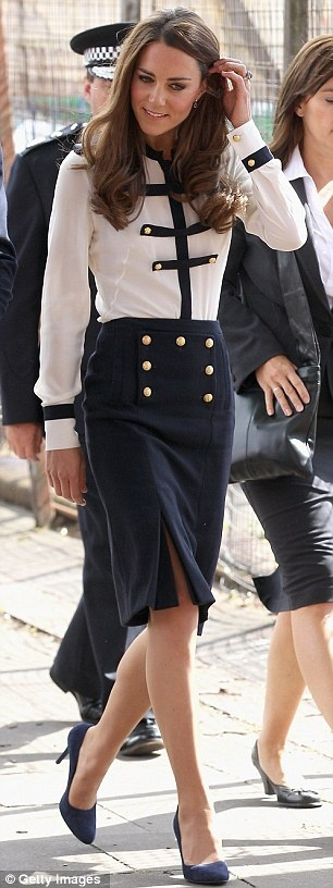 #katemiddleton visited victims of the Riots today and wore a silk blouse and matching pencil skirt by Alexander McQueen designer Sarah Burton