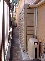 Wish I could afford and find one of these Slimline rainwater collection tanks here.  So sleek.
