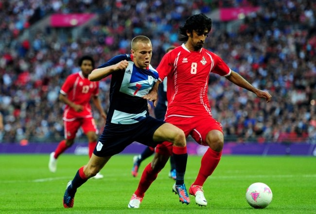 Football/Soccer - Great Britain vs. UAE: Bellamy, Giggs, Cleverley Inspire Hosts to First Victory:    This was the victory a football-mad nation longed to see, the Olympic fire a patchwork national side simply had to find.    So now that the flame is lit, is this the squad that could set cold British hearts aflutter?    Great Britain won for the first time at the Olympics on Sunday, defeating a lively United Arab Emirates side 3-1 before a packed house at Wembley Stadium in London.