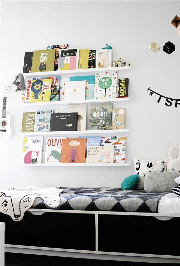 Turning their book collection into wall art.