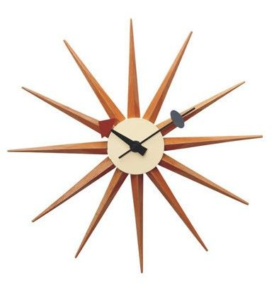 Replica George Nelson Starburst Clock (Natural) -- Our Replica George Nelson Starburst Clock is inspired on the original designs of George Nelson in the 1950's. This bright and interesting design, is a classic retro 50's piece.  Brighten up your home with this funky designer clock.  This inspired design is truly timeless and would suit both the home or workplace. Available in a pure wood finish, this retro piece will delight.--89.0000