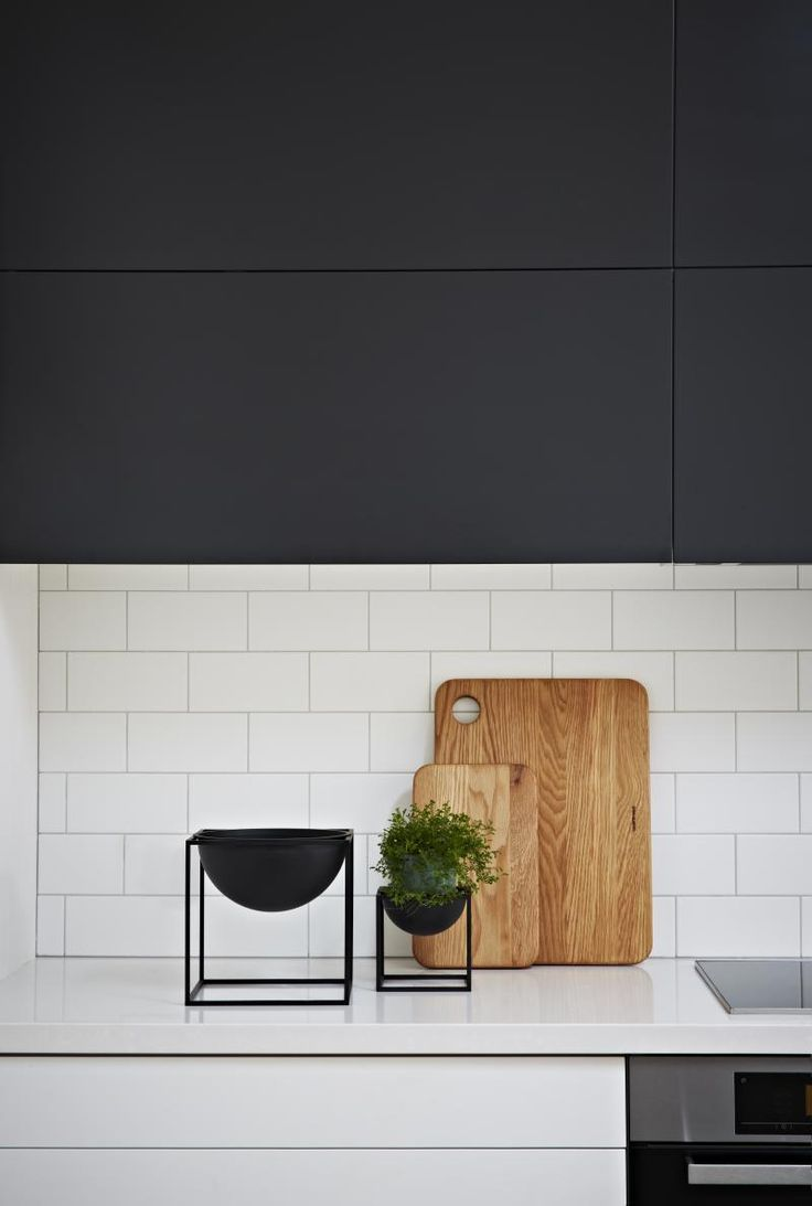 Bench thickness, white and black cupboards and small subway tile.