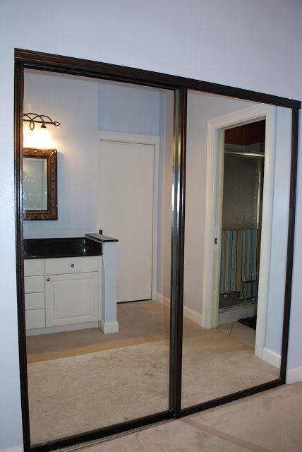 Mirror Closet Door Makeover: Oli rubbed Bronze Spray Paint the frames.