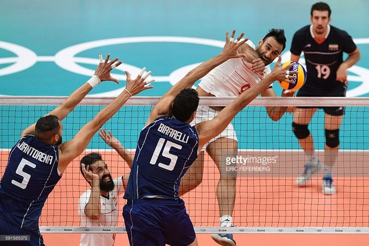 Iran's Adel Gholami spikes the ball during the men's quarter-final volleyball match between Italy and Iran at Maracanazinho Stadium in Rio de Janeiro on August 17, 2016, during the Rio 2016 Olympic Games. / AFP / Eric FEFERBERG