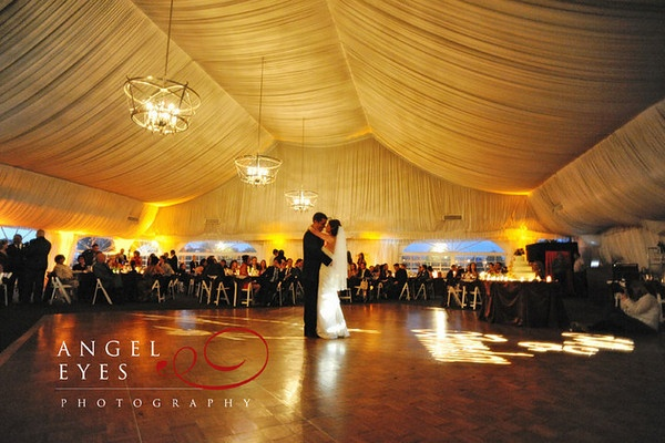 Nice elegant yellow uplighting in a tent. DIY and get the look for your event at http://RentUplights.com