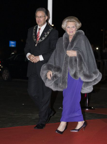 Rotterdam Mayor Ahmed Aboutaleb (L) and Princess Beatrix of The Netherlands arrive to attend a celebration of the reign of Princess Beatrix on 01.02. 2014 in Rotterdam, Netherlands.