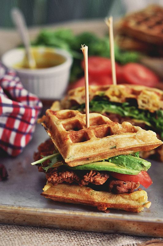 Fried Chicken and Waffle Sandwiches mm mm.  ~~Waffles ~~Flour + baking soda + buttermilk + brown sugar + salt + bacon + butter + eggs + cheddar cheese  ~~Chicken ~~chicken breast cutlets + buttermilk + flour + cayenne powder + garlic powder  ~~Mustard Maple Syrup ~~maple syrup + mustard