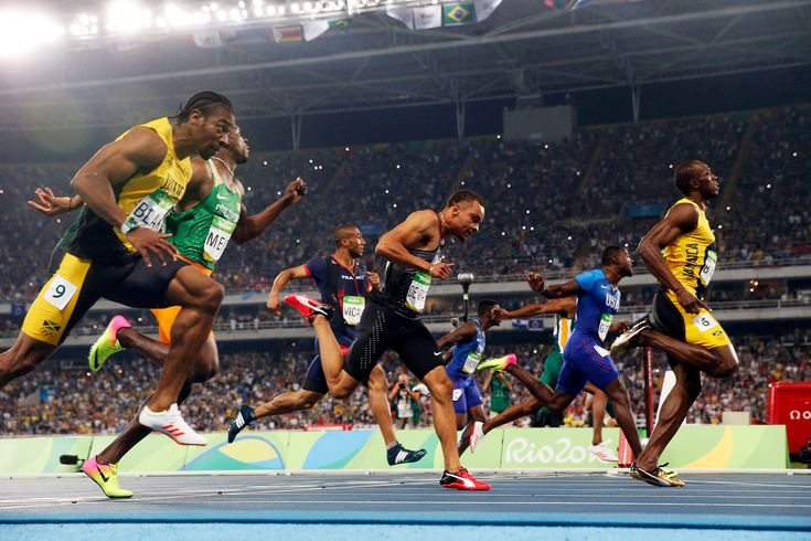 Usain Bolt of Jamaica, right, at the finish line of the 100-meter dash at the 2016 Olympics in Rio de Janeiro. Credit Doug Mills/The New York Times