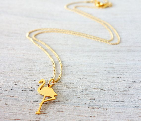 A tiny flamingo pendant, hanging on a delicate chain. Beautifully packed in a small glass bottle with a cork, ready to give in a gift box.  Made of high quality gold or silver plated brass base, and you will receive a 1 year warranty.  Available sizes: L - Adult chain length: 43cm - 17. S - Child chain length: 35cm - 13.8.  If you are purchasing the item as a gift you can ask us to add your personal note.   Want to see more Tiny pieces? click https://www.etsy.com/shop/shlo...