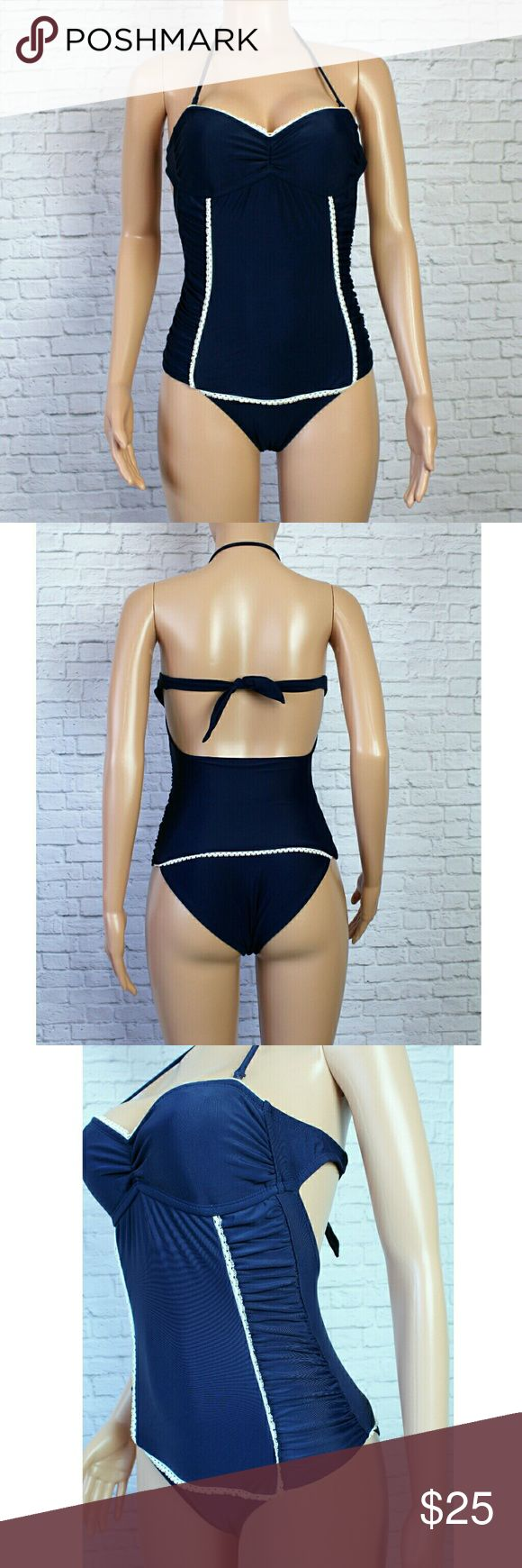 VM Blue & White Lace One Piece Swim suit Adorable dark blue one piece with lace detail. Has removable halter straps, back tie and ruching on the sides. The bust pads are removable. Size Small  NWOT VM Swim One Pieces