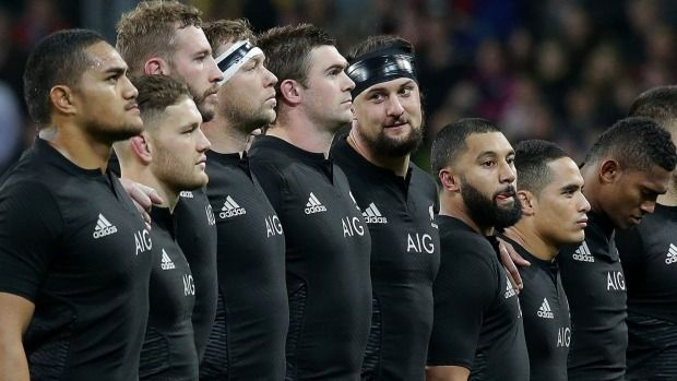 Elliot Dixon looks at Highlanders teammate Liam Squire before the national anthem.