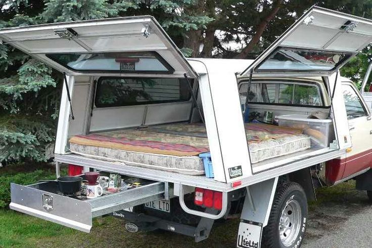 Bolt a pickup topper onto a flatbed and throw a mattress in.  Love the slideout drawer under the bed