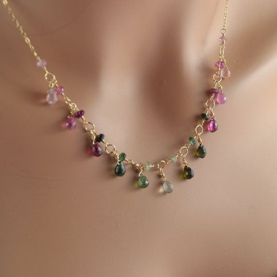 Elegant tourmaline necklace drips with sparkly gemstones in all shades of pink and green. Teardrop-shaped tourmaline stones create the glittery