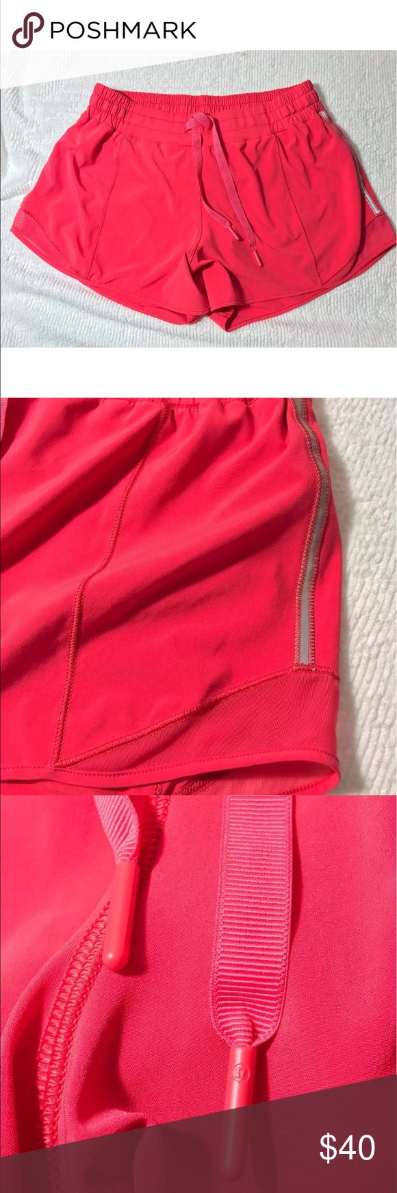 "Lululemon hottie hot pink shorts 10 tall Lululemon Size 10 tall Style Name is  Hotty Hot Short   Coral Pink Color They are in perfect condition. Look unused.  Inseam is 4"" outseam is  11"" Lining inside lululemon athletica Shorts"