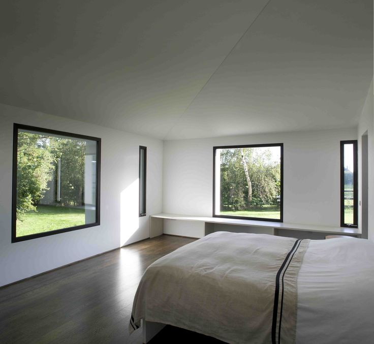 Master bedroom with black frame window views to countryside, © Paul Tierney