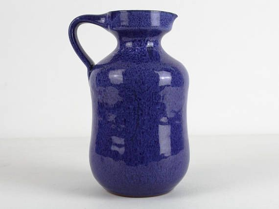 Studio pottery by Röemhild, 70s. Fantastic night blue glossy glaze, eccentric shape. The pottery Römhild has a history since 1720. In GDR it became converted into VEB. The pottery still works today under the name Gramann. condition: excellent vintage 19,5 cm / 7,68 inch wight: 738 g basemark: marked by Roemhild Thank you for your interest! Please contact us to calculate combined shipping. We ship our items insured as international tracked postage by Deutsche Post. Condition of item...