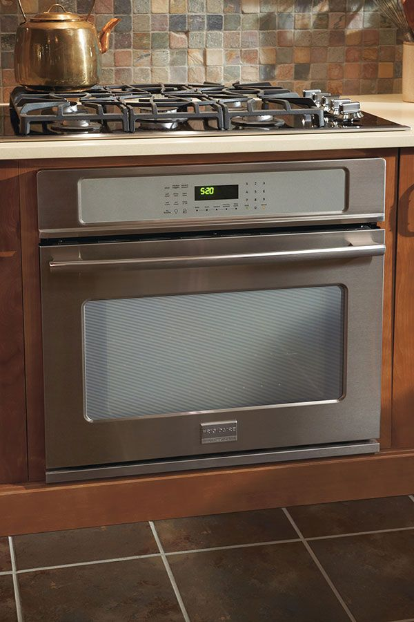 Tucking an oven cabinet under a countertop within the base ...