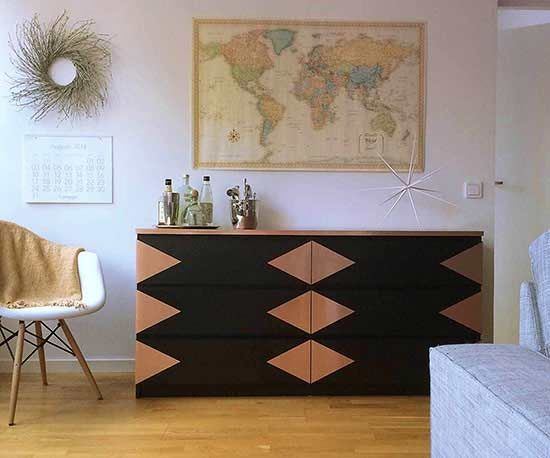 A move overseas left this IKEA dresser looking worse for wear, so Cindy, the crafty blogger at Carole   Ellie, got to work dressing it up with contact paper. With its metallic finish, copper contact paper creates the illusion of depth against a black wood dresser, while a modern triangle design transforms the simple storage item to a shimmering statement piece./