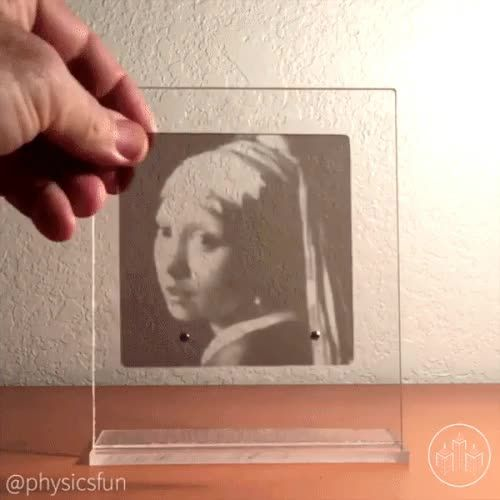 """Monochrome acrylic slides assemble to reveal Vermeer's """"Girl with a Pearl Earring."""""""