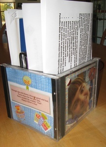 Recycle your old CD cases and make an organizer.  We made a Father's Day organizer for my husband.  I placed photos of the kids on each side and let them decorate their own page.