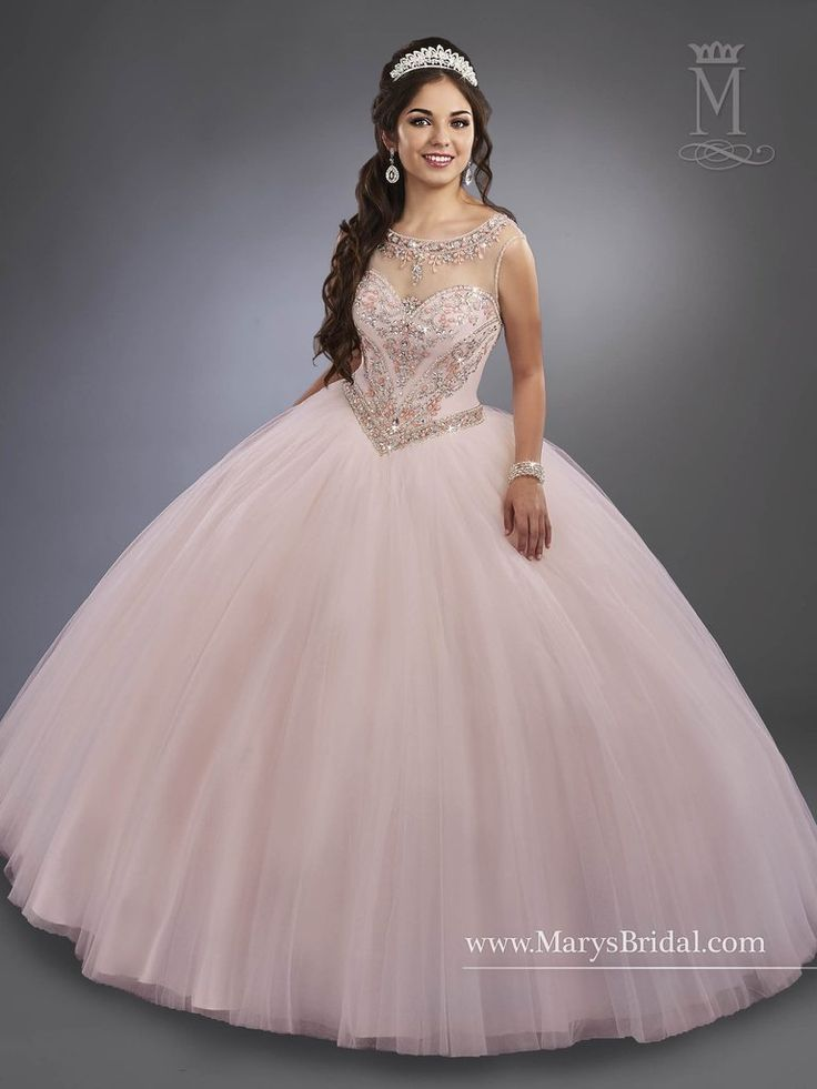 "Make a lasting impression in a Mary's Bridal Beloving Collection Quinceanera Dress Style 4767 at your Sweet 15 party or at any formal event. Tulle quinceanera ball gown featuring beaded bodice with beaded illusion scoop neck line, basque waist line, and sheer back with zipper closure. Colors: Blush, Mint, or White Please allow 4 - 5 months for delivery because Mary's Bridal Quinceanera dresses are made-to-order. If you want to put this ball gown on Layaway, please select the ""Pay 50%…"