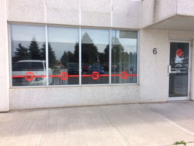 Speedpro Signs Kingston completed a simple yet very effective look by placing coloured vinyl on the outside of Stone City Strength's windows. Perfect!