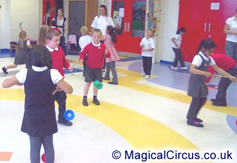 Casterton Primary School children with diabolos during the circus skills workshop.   MagicalCircus.co.uk