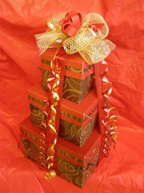 The Chocolate Pizza Company in Marcellus, NY uses our gourmet boxes for elegant gift towers.  http://www.nashvillewraps.com/showpage.ww?page=giftbasket
