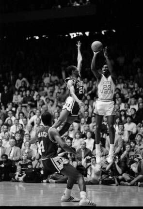 Duke's Johnny Dawkins and Tommy Amaker chase after the GOAT relentlessly in an effort to disrupt his jumper during a game in Chapel Hill North Carolina.