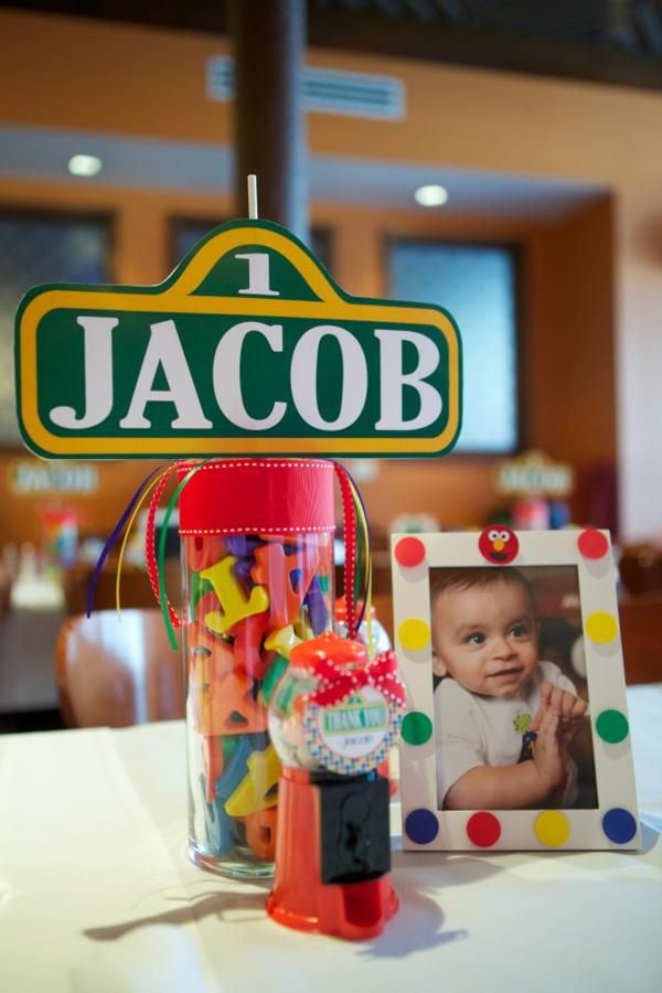 cute centerpiece idea letters, picture and sesame street sign