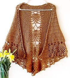 This shawl is crafted from the top down, crocheted using basic stitches to create something unique & feminine. It uses worsted weight yarn, meaning it works up quickly and lends a warmth to it that other shawls rarely possess. This pattern is fully written and also includes a charted section for the lace panel. The upside down pineapple shape (or an autumn leaf, if you will) repeats 3 times down the back, and is then carried into the edging, lending the shawl a whimsical and delicate touc...