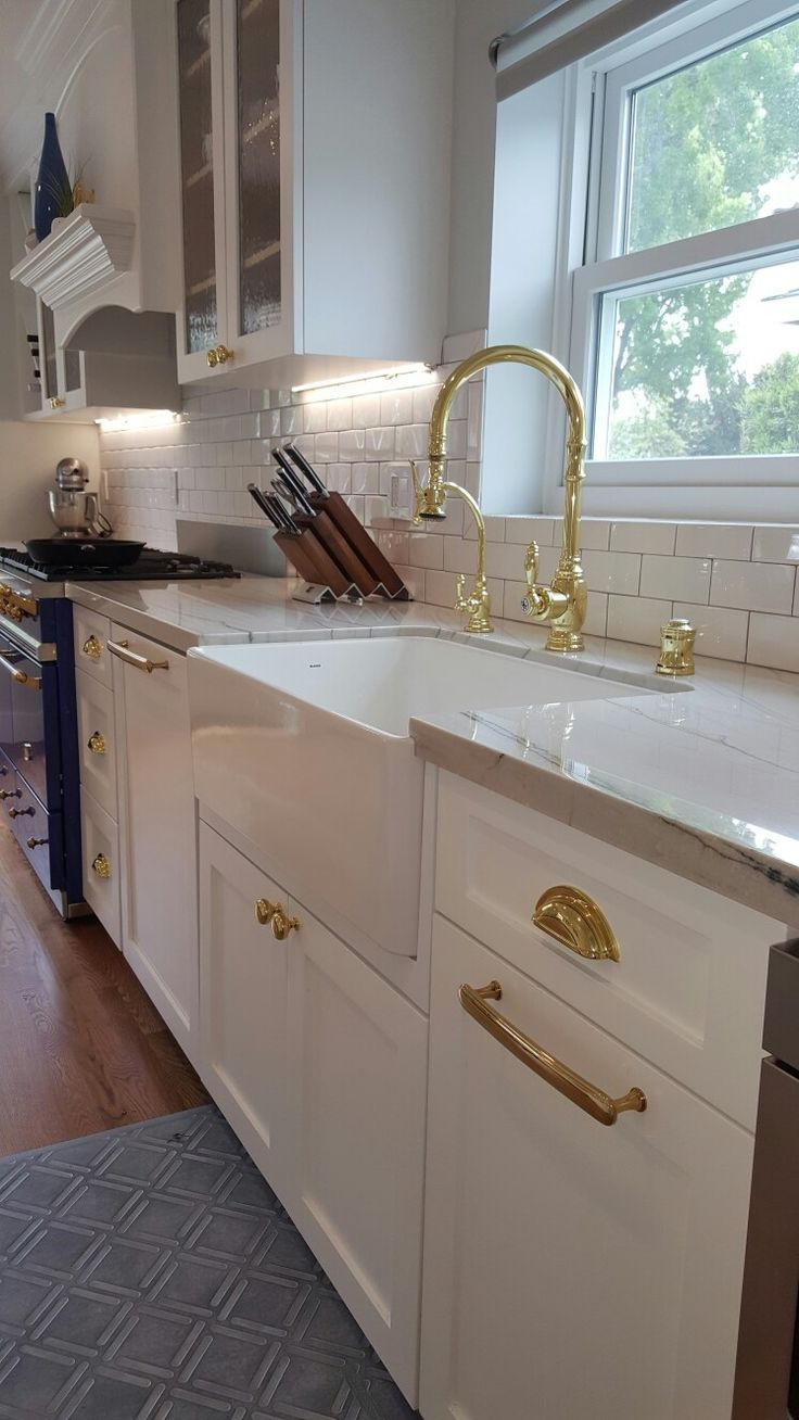 Brass Cabinet Hardware, Brass Waterstone Faucet. Blanco Farmhouse Sink.  Quartzite Countertops: White