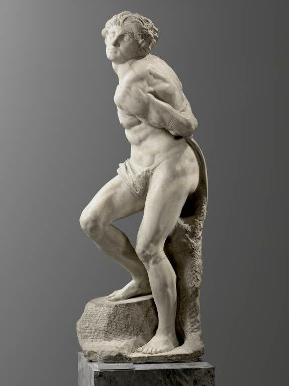 """Michelangelo BUONARROTI dit MICHEL-ANGE Caprese (Arezzo), 1475 - Rome, 1564  Captif (""""l'Esclave rebelle"""")  Marbre H. : 2,09 m.  Exécuté en 1513 - 1515 pour le tombeau du pape Jules II. LOUVRE"""