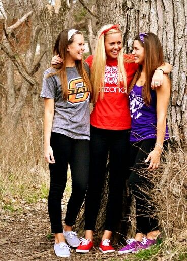 Senior picture with friends wearing the college shirt they're going to