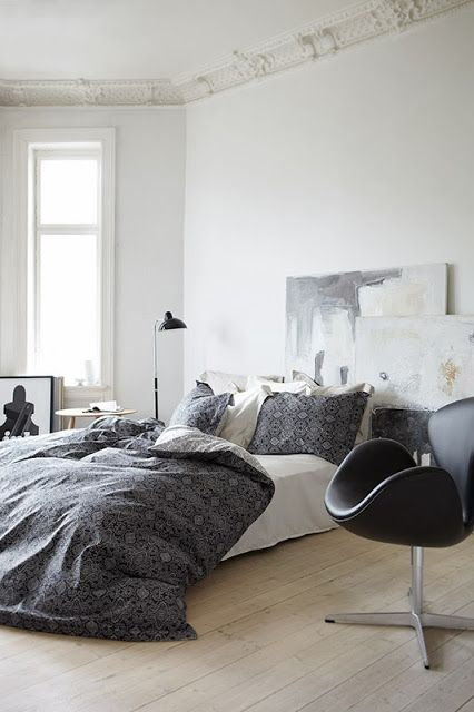 Great concept all-around: low-to-the-ground bed, all-white everything with gray highlights, detailed crown molding to match colour of walls, and leaning artwork for a headboard. Beautiful. Doing it. ~w