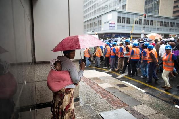 A woman watches as supporters of the South African opposition party Democratic Alliance (DA) march for jobs in Johannesburg on April 23, 2014