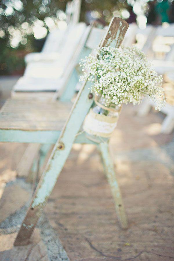 ceremony chair decor // photo by Amelia Lyon // http://ruffledblog.com/elegant-rustic-malibu-wedding