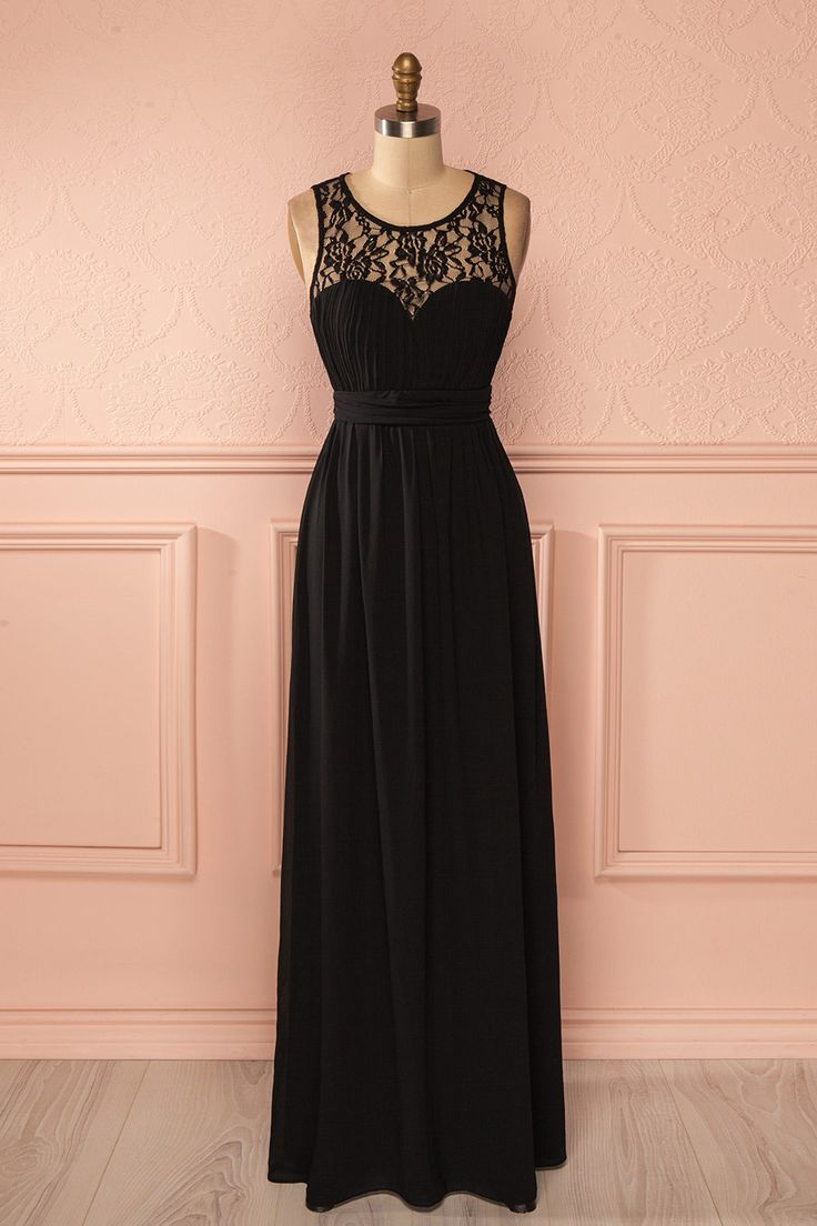 Elle s'avança fièrement vers la grande salle de bal dont elle avait toujours rêvée. She walked proudly towards the grand ballroom she had always dreamed of. Black lace neckline maxi dress www.1861.ca