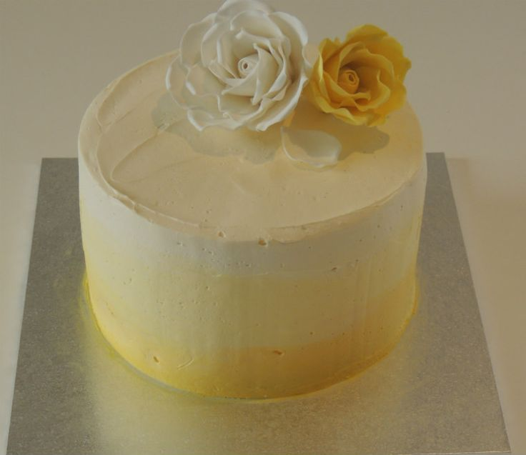 Ombre yellow baby shower cake with rose sugar flowers