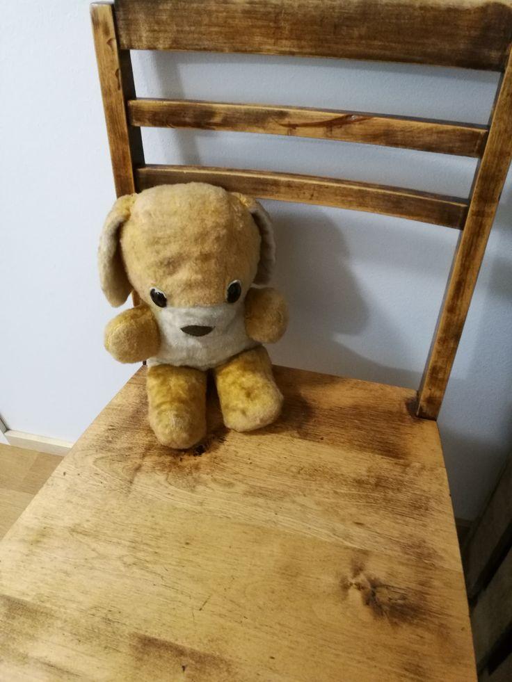 Old chair and old teddybear.