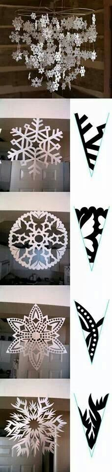 Paper snowflakes hanging decoration. Could we hang something like this above the bar?