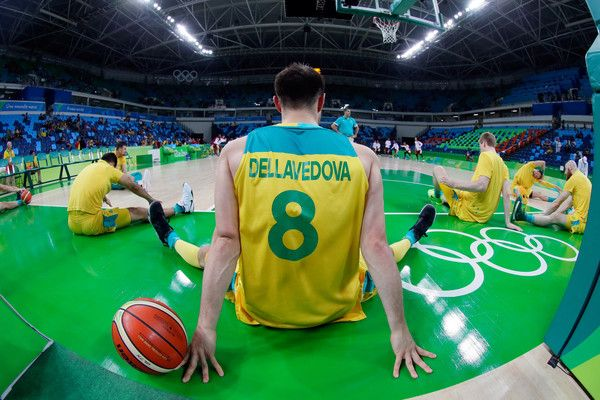 Matthew Dellavedova Photos - Matthew Dellavedova #8 and members of the Australian team stretch prior to the preliminary round game against Venezuela at the Rio 2016 Olympic Games on August 14, 2016 in Rio de Janeiro, Brazil. - Basketball - Olympics: Day 9