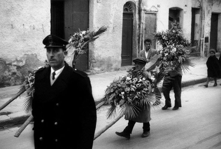 Ferdinando Scianna 1962  Italy, Sicily, Bagheria:Cola Pumincelle bringing a flower guerland...
