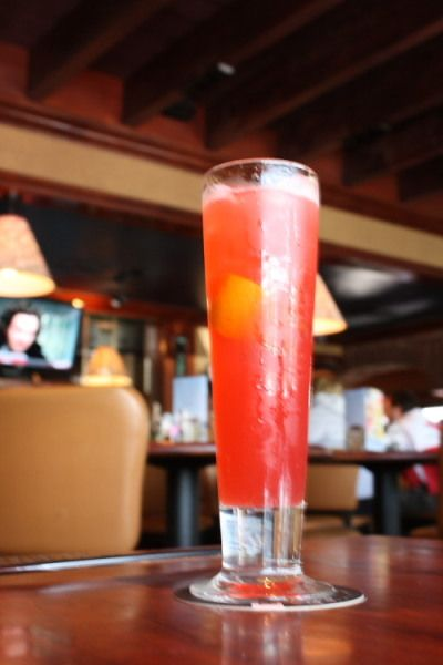 Because I love this drink and I don't really work at Ruby's anymore, here is the recipe .75 peachtree schnapps .75 vodka .75 coconut rum 1 part cranberry juice 2 parts pineapple juice 1 squeezed orange splash grenadine and BAM!