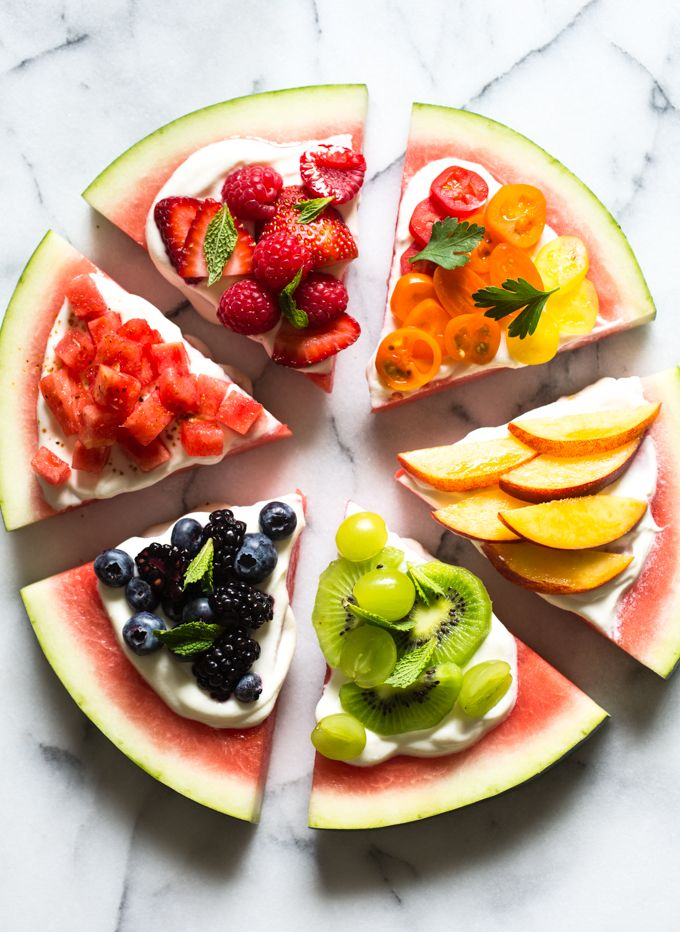 This Watermelon Pizza is far from traditional, but it's super tasty, healthy and so, so pretty.  The crust here is made of wedges of juicy, ripe watermelon, the cheese is a luscious mix of mascarpone and Greek yogurt, and the toppings are a colorful array of sweet, summer produce. This delicious treat is sure to become a summer party staple!