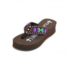 The Amos is a vibrant mix of bright seed beaded and tribal print straps with bronze burst stud studding!